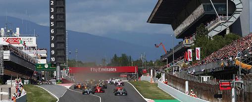 Lewis Hamilton Mercedes leads Valtteri Bottas Mercedes as Sebastian Vettel Ferrari locks up at start of the Spanish F1 race