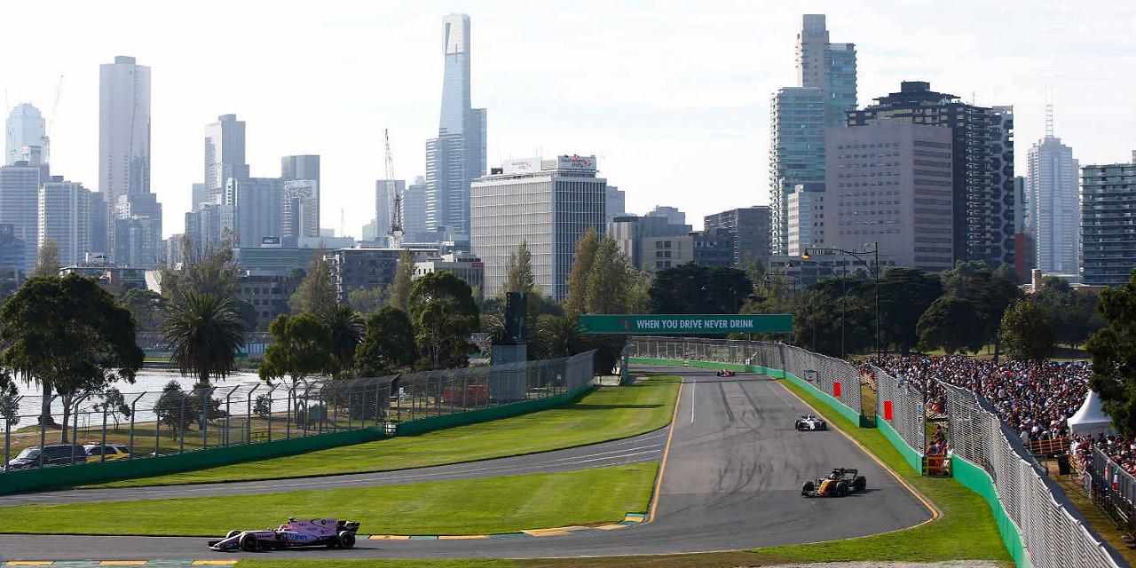 Esteban Ocon, Force India Mercedes, leads Jolyon Palmer, Renault at Albert Park Circuit, the Australian F1 race track