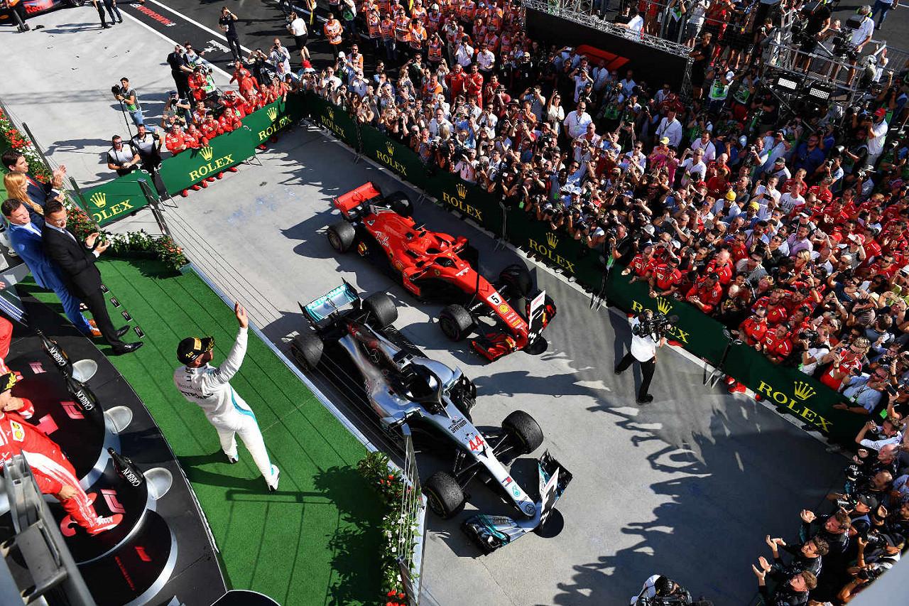 Lewis Hamilton, Mercedes, celebrates in Parc Ferme next to Ferrari Hungaroring, the Hungarian F1 race track