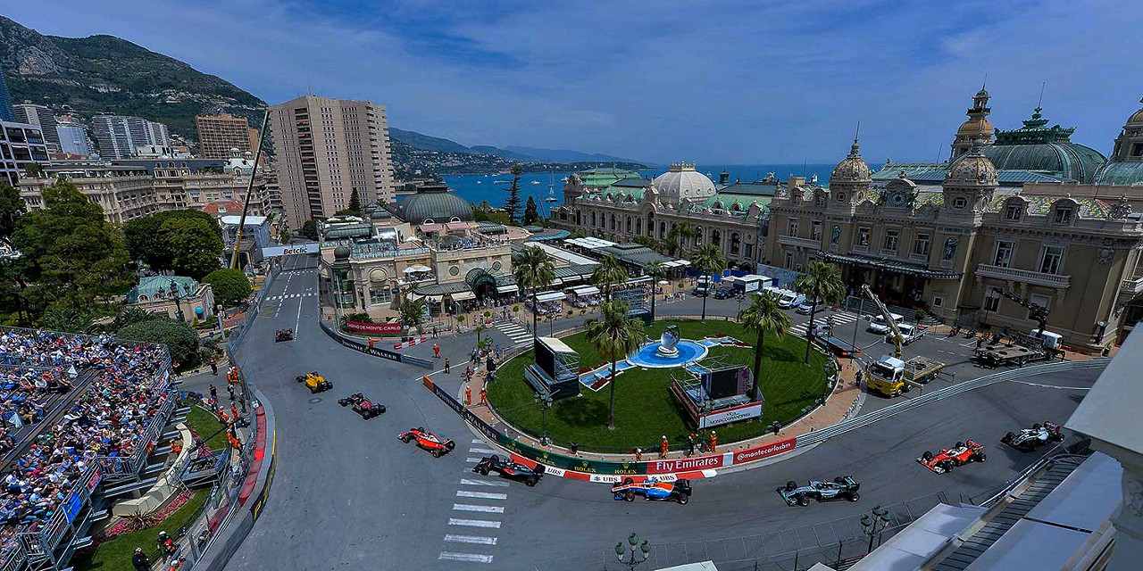 Red Bull Racing team leads outside the casino square at Circuit de Monaco, the Monaco F1 race track