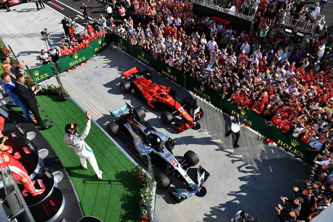 Lewis Hamilton, Mercedes, celebrates in Parc Ferme next to Ferrari Hungaroring, the Hungarian F1 race track